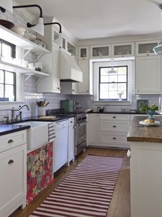 This is a fun kitchen. Love the cabinets! Not the subway tile so much.
