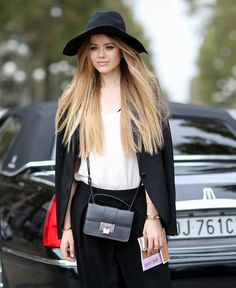 Kristina Bazan Wearing the Jimmy Choo Rebel bag