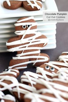 Chocolate Pumpkin Cut Out Cookies decorated like Mummys for Halloween