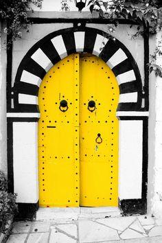 Great art & yellow doors in Mexico.