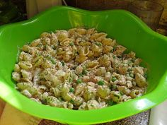 Sweet Tomatoes' Tangy Tarragon Tuna Salad.    Dressing:    1 cup mayonnaise (Kraft made with olive oil),  1/2 cup Kraft light sour cream,  1 Tbsp lemon juice,  1 Tbsp dried Tarragon,  1Tbsp dijon mustard,  1 tsp sugar,  1/4 tsp cinnamon.     Salad:    4 cans tuna, drained,  2 cups frozen green peas,  1 box pasta shells,  1/4 tsp salt,  dash cracked pepper