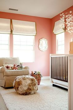 I love these coral walls.  The khaki trim on the blinds is a sleek choice paired with the over the top girly poof.