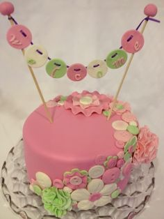 Button Baby Shower Cake #pink #green #girl baby shower cakes, button parti, button cake, buntings, shower idea, button babi, babi shower, birthday cakes, baby showers