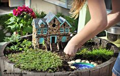 Crow's Feet Chic: Our Fairy Garden.  The attention to detail on this is spectacular and doable.  Must read if you have little girls who adore fairies...