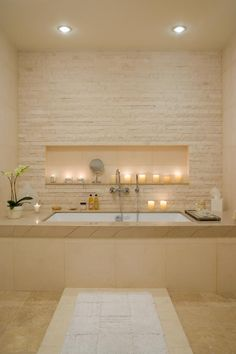 stunning pale stone bathroom <3 - I would love to have a stone wall like this in the living room behind the tv