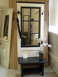 great idea for DIY -- old door and bench and vintage mirror re-imagined as hall tree