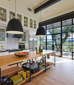 Beautiful kitchen with floor-to-ceiling windows and nature as a backdrop | Olive Grove Residence by Total Concepts