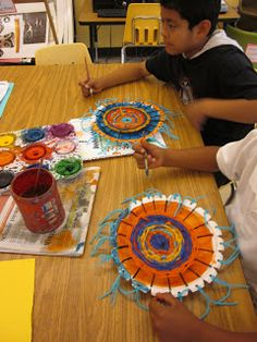 The Lake Forest Louvre: Third Grade RADIAL Weavings - like the hole punch fringe additions - add to my circle weaving project.