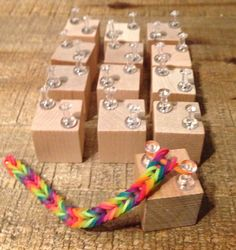 Do-It-Yourself Rainbow Loom Party Favors ~ Use wood blocks with pushpins to make fishtail bracelets. The kids can even take them home to finish later.