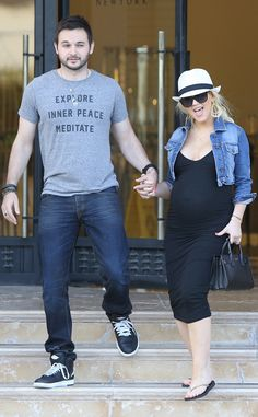 The expectant couple take a romantic stroll in West Hollywood.