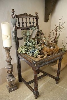 how interesting  Use chair to creat vignette...no more sitting on chairs.