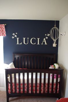 A navy-and-coral themed nursery that's simple yet elegant featuring the Infinity Convertible Crib.  #infinity #crib #baby #nursery #babysdream #navy #coral