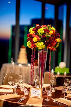 The beautiful centerpieces were so lovely in the gorgeous reception space! ::Meghan + John's boldly beautiful fall wedding at the Catholic Church of St. Ann and the Buckhead Club in Atlanta, Georgia:: #buckheadclub #atlantawedding #sunset #weddingcake #tablesetting #eventdesign @Brinda Howard Shah Club