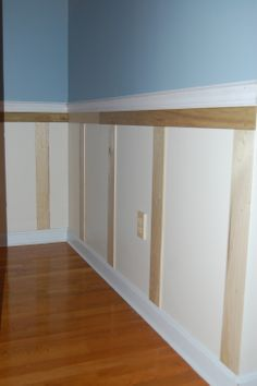 DIY Wainscoting: This simple update makes the room look more put-together and tasteful.