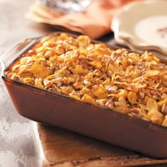 Crunchy Sweet Potato Casserole Recipe from Taste of Home. Tasty seasonings like cinnamon and nutmeg and a crunchy corn flake and walnut topping make this a terrific Thanksgiving side dish. —Virginia Slater, West Sunbury, Pennsylvania