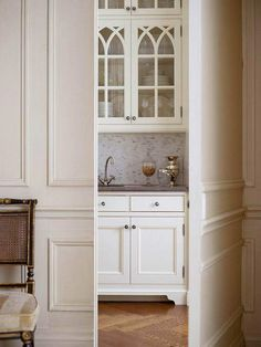 Hidden Pantry Door: In my dream home, even the butler's pantry would be a place I would want to spend time in. This is one is sooo clever because no one needs to even know about it. But who would keep it a secret? Simply beautiful. The detail on the cabinets allow the beauty and the organization of the china to show.