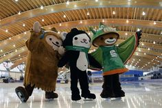 Vancouver 2010 Winter Olympic Games mascots Quatchi, left to right, Miga and Sumi skate on the ice at the Richmond Olympic Oval in Richmond, B.C., on Tuesday January 20, 2009.