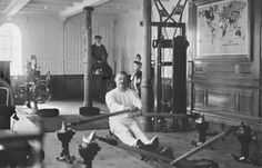 UIG450665 Gymnasium on the Titanic, 1912 (b/w photo) by Browne, Father Frank (1880-1960); black and white photograph; (add. info.: Gymnasium of White Star Liner, RMS Titanic; TW McCawley, 'physical educator or trainer' on a rowing machine and electrician William Parr on a mechanical camel; Both perished when the steamship sank