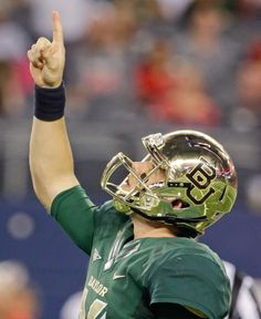 Baylor quarterback Bryce Petty points to the sky after his team scored a touchdown against Baylor. Baylor won, 63-38. (LM Otero/AP)
