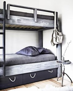 How great is this custom bunk bed in black and grey from Coco cozy? It feels like something both kids and adults would love sleeping in.