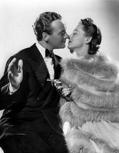 """David Niven y Olivia de Havilland en """"Caballero y ladrón"""", 1939"""