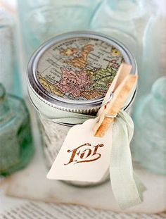 Map Covered Mason Jar.  Maybe fill with mini travel toiletries for a travel theme.