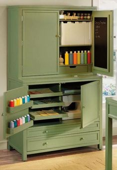 craft cabinet- Such a great idea for an armoire.Saw one at Goodwill yesterday...may have to go back now!