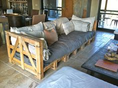 Pallet Couch. Perfect for my kids. Save the expensive couch for a different house with an adult living room or wait until they are older.