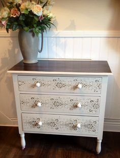 Elegant three drawer chest on castors painted in custom mix country grey and roller stencil in olive green #general finish #java gel for refinished top  Painted by Home Revival