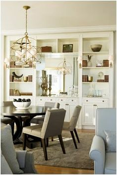 built ins around a mirror can be so nice, doubling the chandelier light