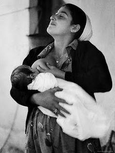 proud mama breastfeeding.