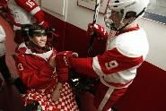 """Jack Jablonski rejoined his hockey teammates before a playoff game. """"It's home,"""" Jabs said of returning to the arena where he was hurt."""