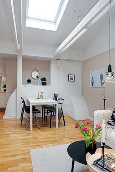 Awesome Stockholm Attic Apartment Design in Scandinavian Interior: Comfortable Attic Apartment With Wooden Door White Ceiling And The Brown ...