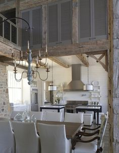 Rustic Kitchen  #Rustic #Kitchen Love the suspended chandelier and the two  islands in the kitchen.