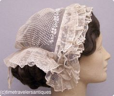 1850s finely hand-embroidered fancy tulle day cap, trimmed in ruffled Mechlin lace. Adjustable twill tape drawstring at the back.