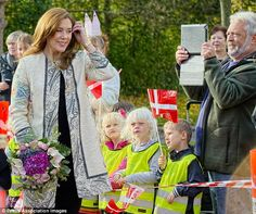 Blooming lovely: She was presented with a bouquet of fresh flowers to mark her appearance
