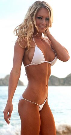Sexy girl in white bikini. More sexy women at http://sexy-calendars.net/