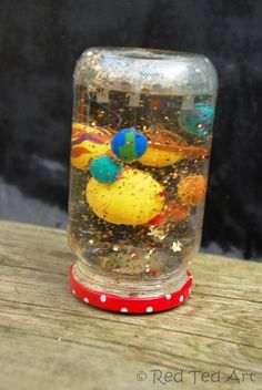 DIY Solar System Snow Globe. I want to do this project with my nephew and niece.  It combines so many elements I love… Polymer clay, creativity, glitter, and science.
