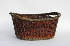 Oval willow laundry basket by Katherine Lewis