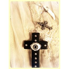 Evil eye matte black cross and coyote tooth by gigideluxe on Etsy, $95.00