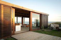 Fabulous sliding screens on this Martin Gomez Arquitectos beach house in Uruguay. via Gardenista