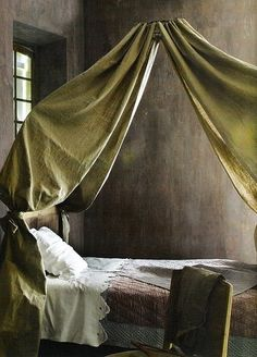 Silk draping over french day bed in the south of france