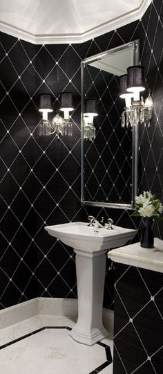 Powder Room - The black 'diamond' patterned walls are bang on!  A hit of glam with the wall sconces makes this one stunning powder room.