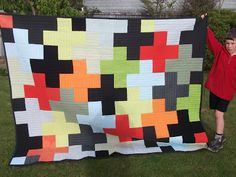 this quilt reminds me of the tetris video game.  i love the bright colors!