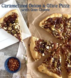 Caramelized Onion and Olive Pizza with Goat Cheese | Taking On Magazines | www.takingonmagazines.com | It doesn't get much more awesome than this. Sweet, caramelized onions, salty olives and tangy goat cheese make up this delicious pizza.