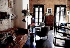 Hardwood floor: check, exposed brick: check, spiral staircase: check. Yup, that's about right.