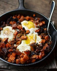 Savory, garlicky sweet potato hash, roasted with sausage and rosemary, and baked the next day with eggs on top.