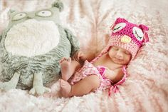 What an adorable newborn photo shoot! This knit hat and her smile is too cute.