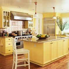 Buttery Yellow Kitchen - love the beadboard and back splash