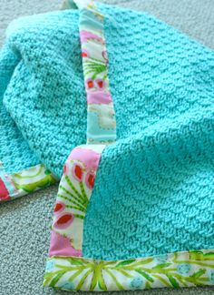 Love the fabric edge on this crochet blanket
